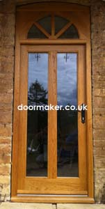 oak doors arched toplight
